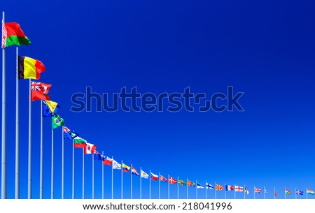 Flags against blue sky, copyspace  - stock photo