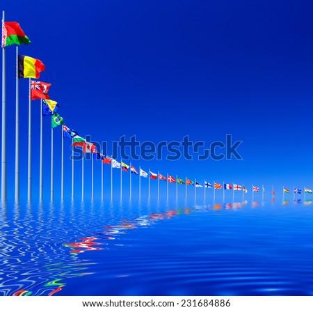 Flags against blue sky, copyspace  - stock photo