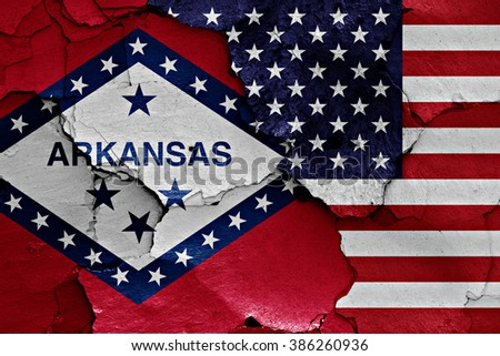 flags of Arkansas and USA painted on cracked wall - stock photo