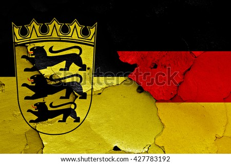 flags of Baden Wurttemberg and Germany painted on cracked wall