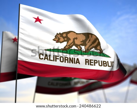 flags of California on blue sky background - stock photo