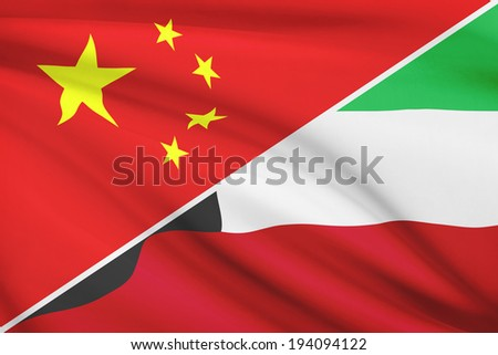 Flags of China and State of Kuwait blowing in the wind. Part of a series. - stock photo