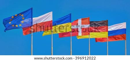 Flags of Different Countries on a Background of Blue Sky - stock photo