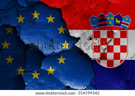flags of EU and Croatia painted on cracked wall
