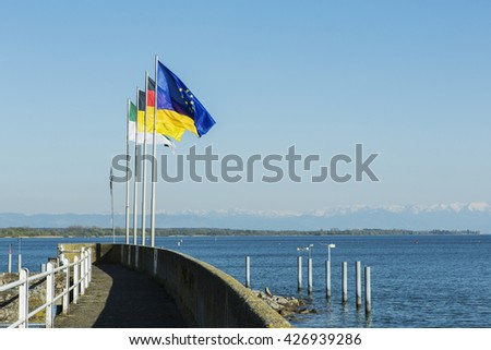 Flags of Germany and Europe at Lake Constance in Friedrichshafen harbor. - stock photo