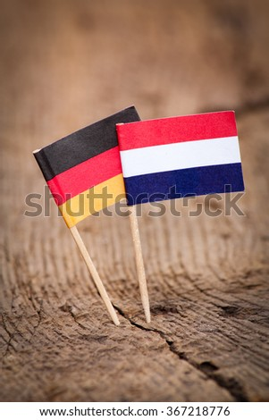 Flags of Germany and Netherlands on wooden background - stock photo