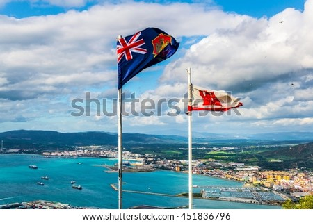 Flags of gibraltar with landscape on background. - stock photo