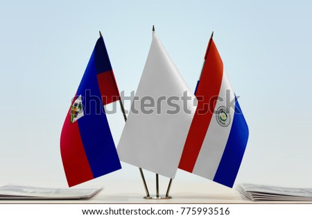 Flags of Haiti and Paraguay with a white flag in the middle