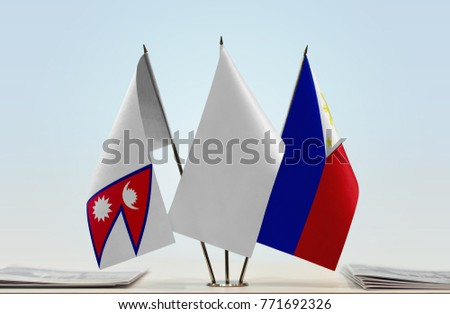 Flags of Nepal and Philippines with a white flag in the middle