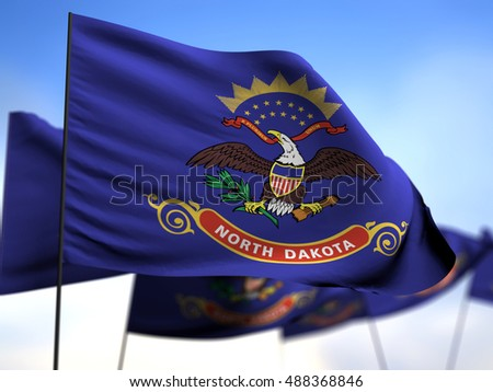 flags of North Dakota on blue sky background