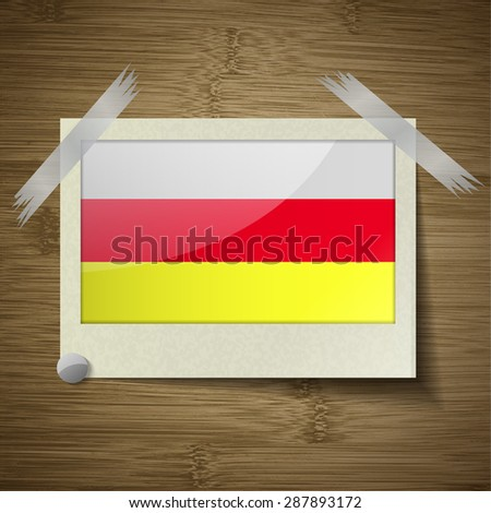 Flags of North Ossetia at frame on wooden texture.  illustration. Rastrized version - stock photo