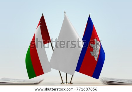 Flags of Oman and Cambodia with a white flag in the middle