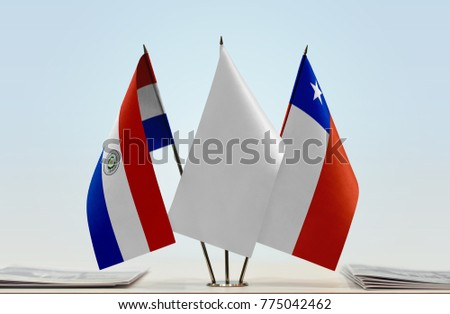 Flags of Paraguay and Chile with a white flag in the middle