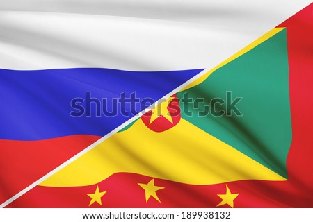 Flags of Russia and Grenada blowing in the wind. Part of a series. - stock photo