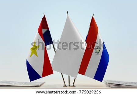 Flags of Saba and Paraguay with a white flag in the middle