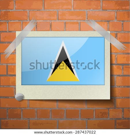 Flags of Saint Lucia scotch taped to a red brick wall.  Rasterized version - stock photo