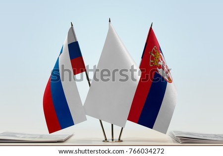 Flags of Slovenia and Serbia with a white flag in the middle