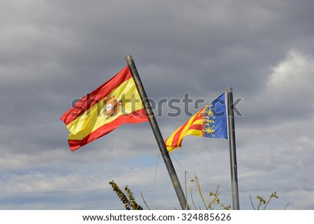 Flags of Spain and Valencia flying at the entrance to the port in Valencia. Spain - stock photo