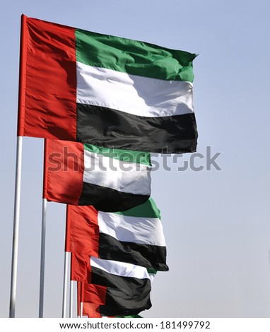 Flags of the United Arab Emirates. It contains the Pan-Arab colors red, green, white and black, which symbolize Arabian unity. - stock photo