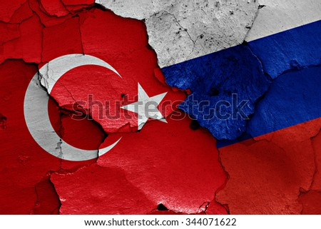 flags of Turkey and Russia painted on cracked wall - stock photo