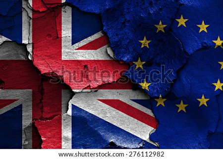 flags of UK and EU painted on cracked wall - stock photo