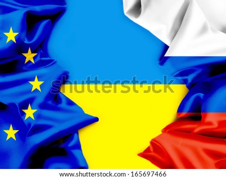 Flags of Ukraine, the European Union and Russia. Conflict. - stock photo