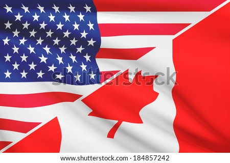 Flags of USA and Canada blowing in the wind. Part of a series. - stock photo