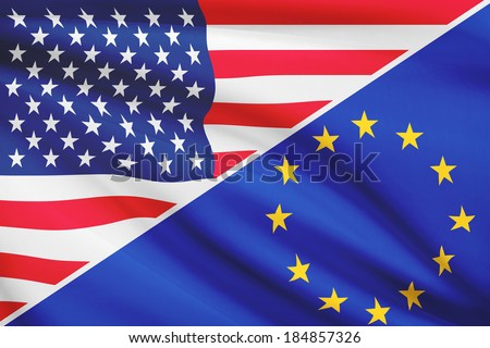 Flags of USA and European Union blowing in the wind. Part of a series. - stock photo