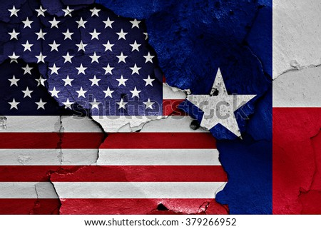 flags of USA and Texas painted on cracked wall - stock photo