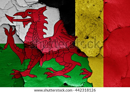 flags of Wales and Belgium painted on cracked wall - stock photo
