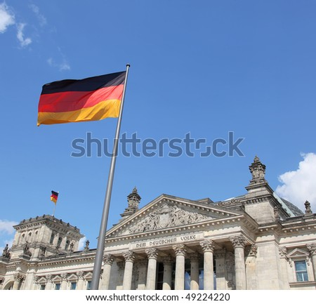 Flags over the Reichstag building in Berlin: German parliament - stock photo