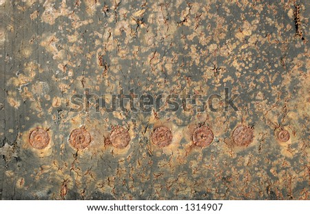 flaking rusty metal with circles - stock photo