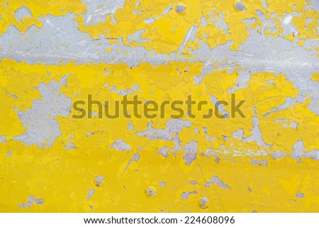 flaking yellow paint on an old aluminum boat background texture - stock photo
