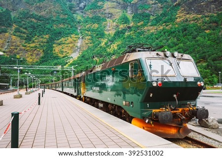 Flam, Norway - August 2, 2014: Flamsbahn In Flam, Norway. Green Norwegian Train On Railway. Famous Railroad - stock photo