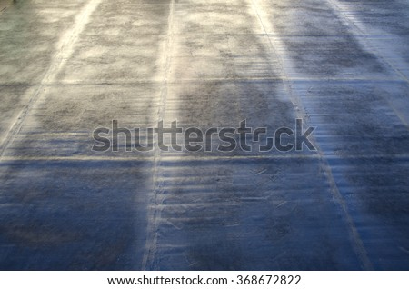 flame during welding of a waterproofing membrane on a roof - stock photo