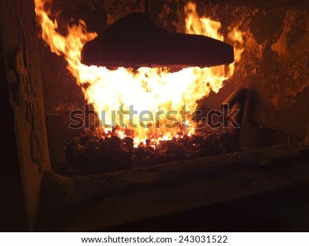 flame in a small coal-boiler - stock photo