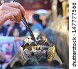 Flame in Wat Phra That Doi Suthep, Chiang Mai, Thailand - stock photo