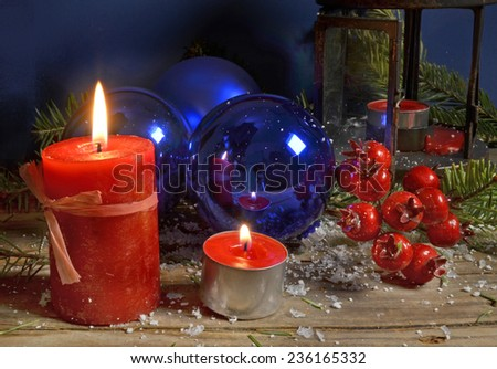 flame - red candles blue balls firs and berries - xmas background
