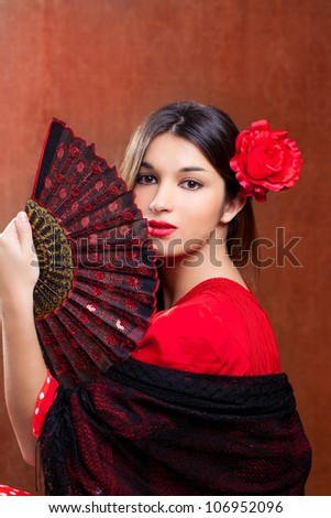 Flamenco dancer Spain woman gipsy with red rose and spanish hand fan - stock photo
