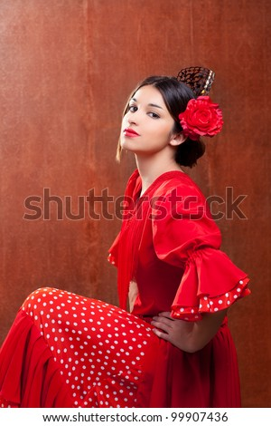 Flamenco dancer Spain woman gipsy with red rose and spanish peineta comb - stock photo