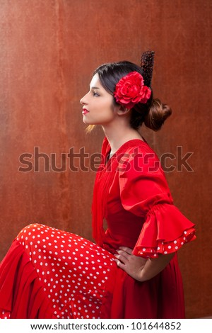 Flamenco dancer Spain woman gypsy with red rose and spanish peineta comb - stock photo
