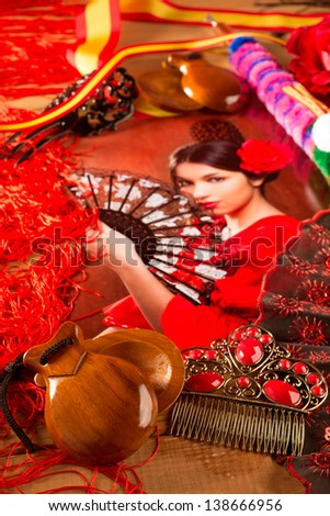 Flamenco woman with bullfighter and typical Spain Espana elements like castanets fan and comb - stock photo