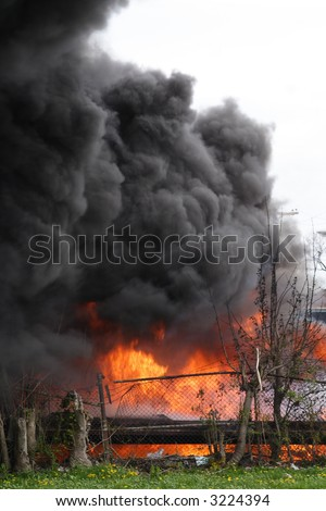 Flames and billowing smoke from a truck fire - stock photo