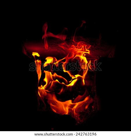 Flames erupt from the combustion chamber of the furnace, on a black background