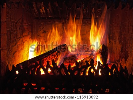 Flames of fire in a fireplace - stock photo