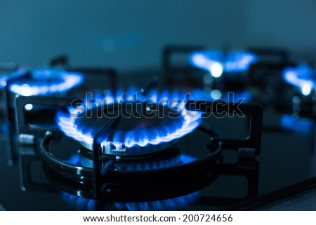 Flames of gas stove (shallow DOF) - stock photo