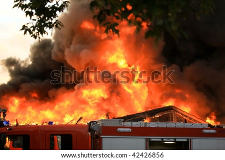 Flames over building - stock photo
