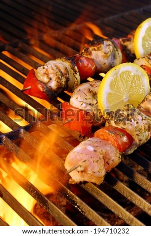 Flaming  BBQ grill and meat kabobs. You can see more BBQ food, BBQ Tools, Flaming Grill, Burning&Glowing Coal in my image gallery and public sets.  - stock photo