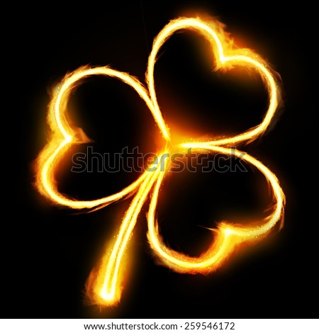 Flaming clovers for St. Patrick`s day - stock photo