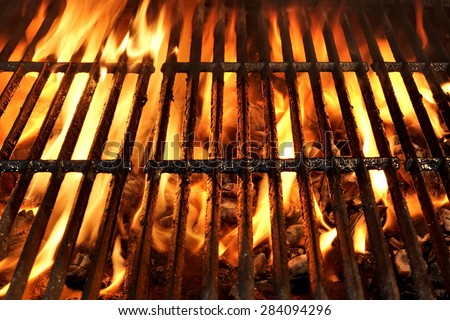 Flaming Empty BBQ Charcoal Grill Close-up Background Texture - stock photo